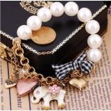 Wholesale - Vintage Multielement Bracelet with Pearl Elepahat & Peach Heart & Bowknot Pendants