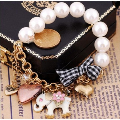 http://www.orientmoon.com/16084-thickbox/vintage-multielement-bracelet-with-pearl-elepahat-peach-heart-bowknot-pendants.jpg