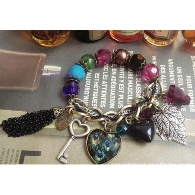 http://www.orientmoon.com/16087-thickbox/faddish-alloy-bracelet-with-tassels-peacock-peach-heart-leaf-pendants.jpg