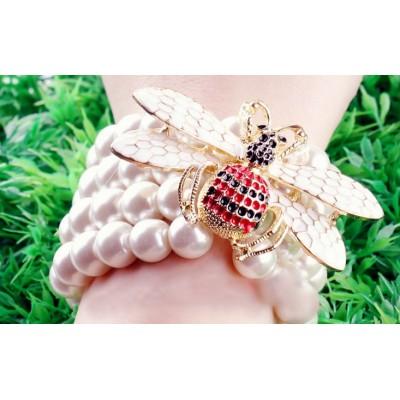 http://www.orientmoon.com/16116-thickbox/faddish-bee-multilayed-pearl-stretchy-bracelet-tk078.jpg