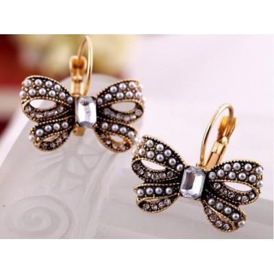 http://www.orientmoon.com/17920-thickbox/vintage-pearl-diamonds-butterfly-earring.jpg