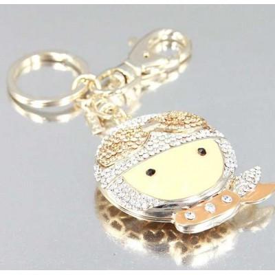 http://www.orientmoon.com/24128-thickbox/stylish-big-head-doll-pattern-diamonds-keychain.jpg