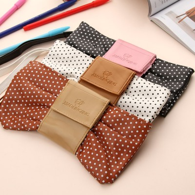 http://www.orientmoon.com/59080-thickbox/pencil-bag-stationery-bag-lovely-bow-tie-design-pu-w2142.jpg