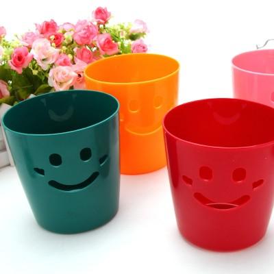 http://www.orientmoon.com/59126-thickbox/desktop-storage-bucket-smile-face-design-pure-color-e9071.jpg