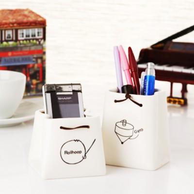 http://www.orientmoon.com/59302-thickbox/ceramic-pen-holder-storage-cup-pot-creative-k1034.jpg