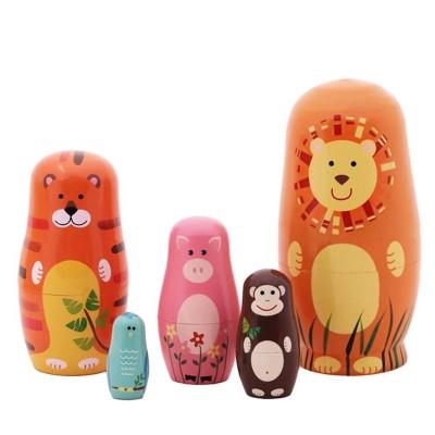 https://www.orientmoon.com/104409-thickbox/5pcs-russian-nesting-doll-handmade-wooden-cute-cartoon-animals-pattern.jpg